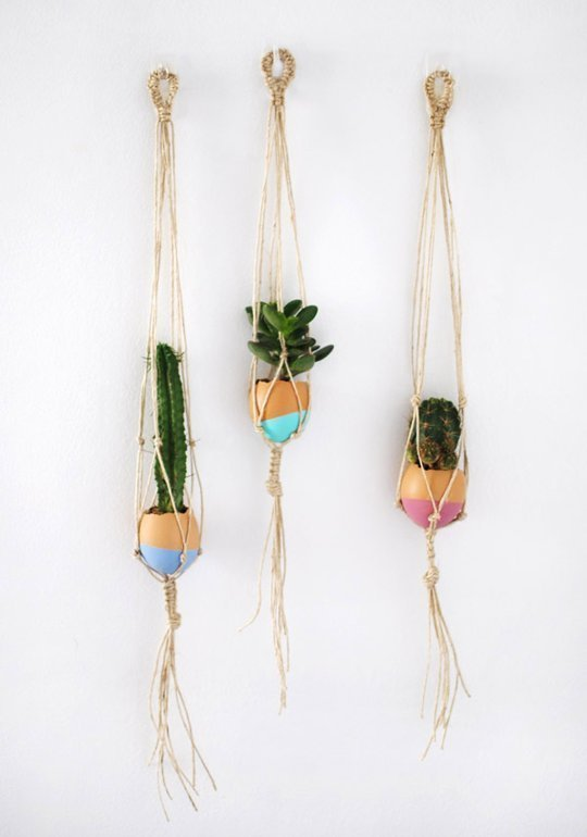 http://www.apartmenttherapy.com/diy-home-decor-15-diy-takes-on-classic-macrame-hanging-planters-200438